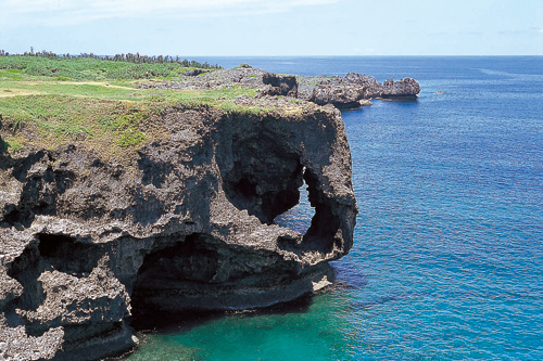 The dynamic natural scenery of the emerald green ocean and steep cliffs made from the elevated coral reef is a must-see.