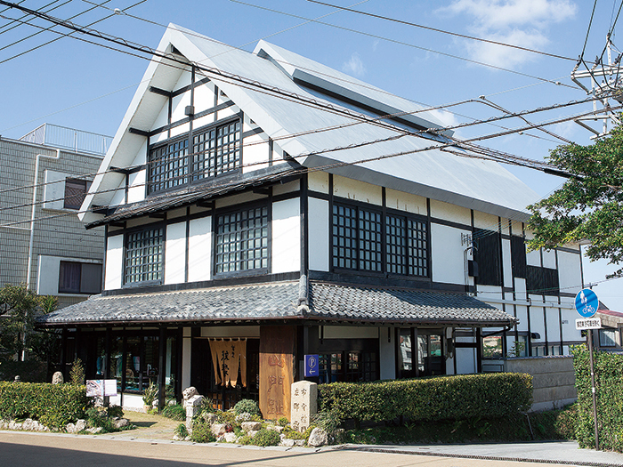 This building is a Gashotsukuri which is a traditional Japanese house with a steep thatched roof, and a roof space
