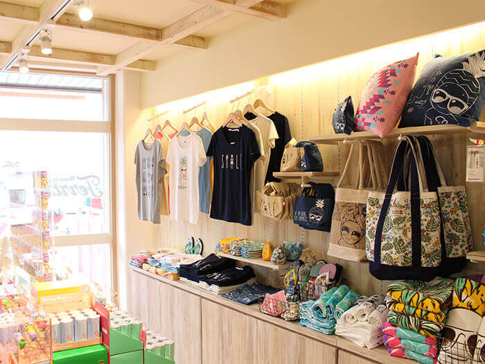 There is an array of store-exclusive products lined-up in the tree-themed shop.