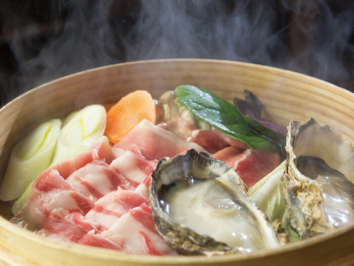 Steaming in a bamboo steamer keeps the umami (savory taste) of Agu from escaping.