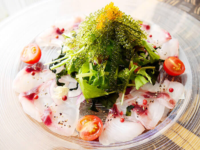 Fresh catches of the day are served as carpaccio,along with Umi Budo and Asa seaweed sauce.