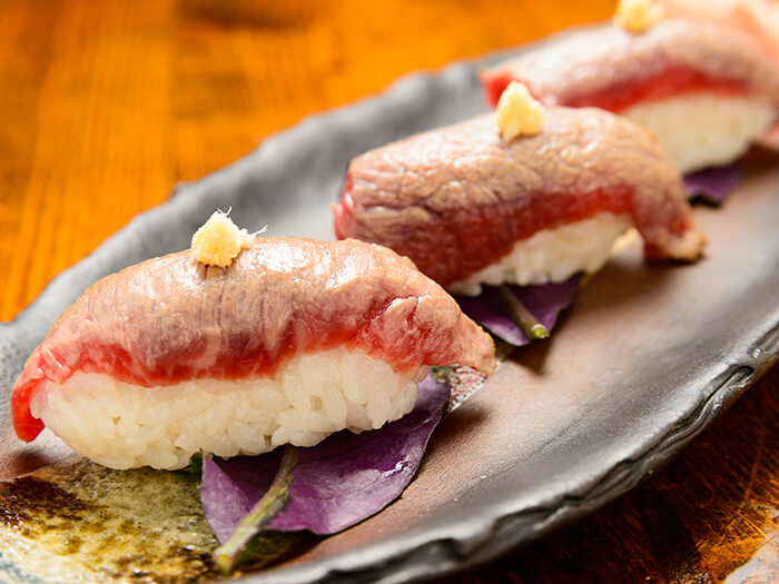 Seared Okinawan Wagyu beef sushi is a limited dish. The beef comes directly from the farm.